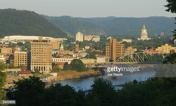 The sun sets on the skyline August 23, 2003 of Charleston, West Virginia. An emergency task force of local, state and federal law enforcement...