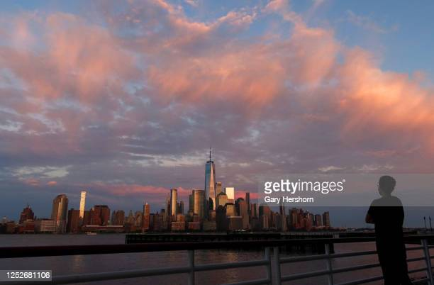 The sun sets on the skyline of lower Manhattan and One World Trade Center in New York City on June 25, 2020 as seen from Jersey City, NJ.