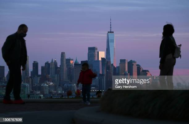 The sun sets on the skyline of lower Manhattan and One World Trade Center in New York City on March 12, 2021 as seen from Weehawken, New Jersey.