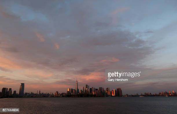 The sun sets on the skyline of New York City on August 6 as seen from Liberty State Park in Jersey City New Jersey