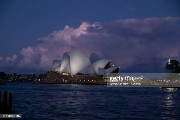 The sun sets on the Sydney Opera House in another day of lockdown on March 26, 2020 in Sydney, Australia. Further restrictions on travel and movement...