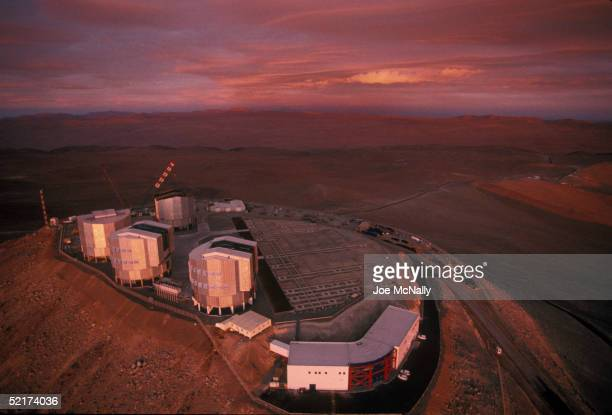 The sun sets on the Very Large Telescope which consists of these four squaredoff domes that stand on the top of the levelled mountain of Cerro...