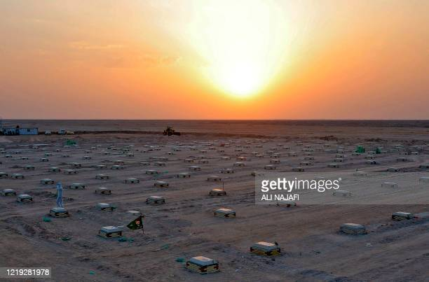 TOPSHOT The sun sets over a cemetery for COVID19 victims 20 km from the central Iraqi holy city of Najaf on June 10 2020