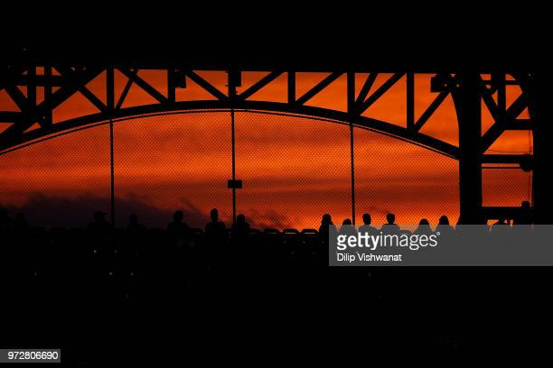 The sun sets over a game between the St Louis Cardinals and the San Diego Padres in the sixth inning at Busch Stadium on June 12 2018 in St Louis...