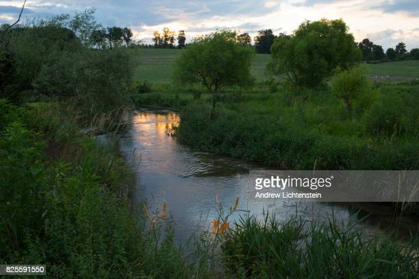The sun sets over a stream on a 18th century farm property on June 30 2017 in Boonsboro Maryland Rural Maryland is increasingly becoming a commuter...