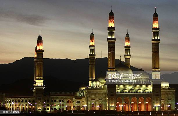 The sun sets over alSaleh mosque in the Yemeni capital Sanaa on January 14 2010 Yemen's council of clerics called on Thursday for jihad if foreign...