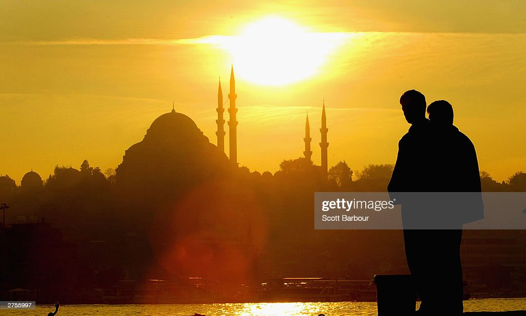 The sun sets over an Istanbul mosque November 23, 2003 in Istanbul, Turkey. Daily life is returning to normal after bomb attacks on the British consulate and the HSBC bank headquarters killed 27 people and left hundreds injured last week.