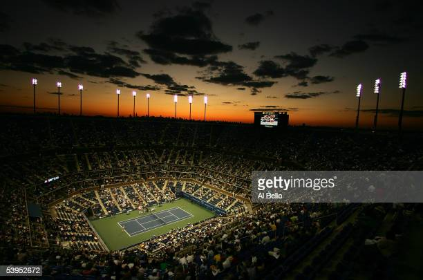 The sun sets over Arthur Ashe Stadium during the second round match between Amelie Mauresmo of France and Sesil Karatantcheva of Bulgaria the US Open...