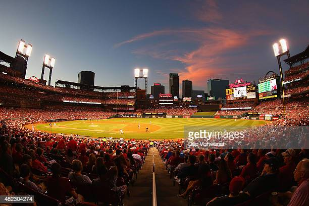The sun sets over Busch Stadium during a game between the St. Louis Cardinals and the Cincinnati Reds on July 29, 2015 in St. Louis, Missouri.