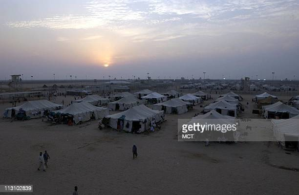 The sun sets over Camp Bucca the USrun detention center 300 miles south of Baghdad Military detention specialists arrived this week to rewrite...