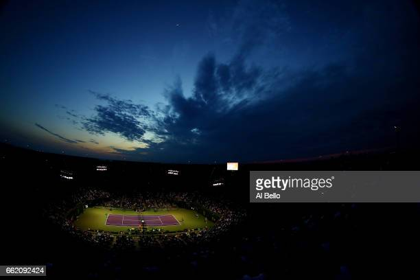 The sun sets over center court during the match between Nick Kyrgios of Australia against Roger Federer of Switzerland during Day 12 of the Miami...