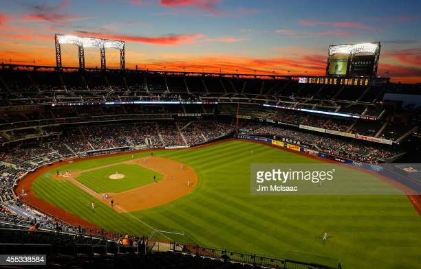 The sun sets over Citi Field during the first inning of a game between the New York Mets and the Washington Nationals on September 12, 2014 in the...