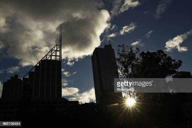The sun sets over Deutsche Bank Place left and other buildings in Sydney Australia on Friday June 1 2018 Australia's banking industry faces an...