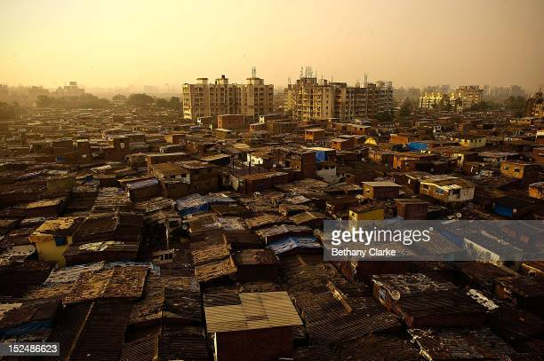 The sun sets over Dharavi November 4 2011 in Mumbai India Dharavi Asia's largest slum situated in the centre of Mumbai One million people live and...