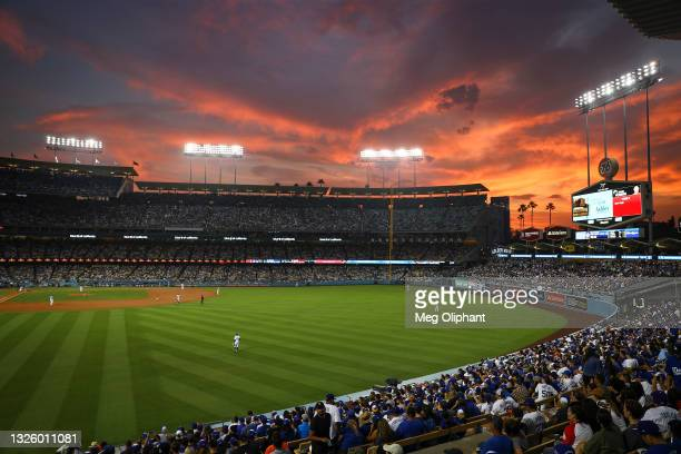The sun sets over Dodger Stadium during the game between the Los Angeles Dodgers and the San Francisco Giants on June 28, 2021 in Los Angeles,...