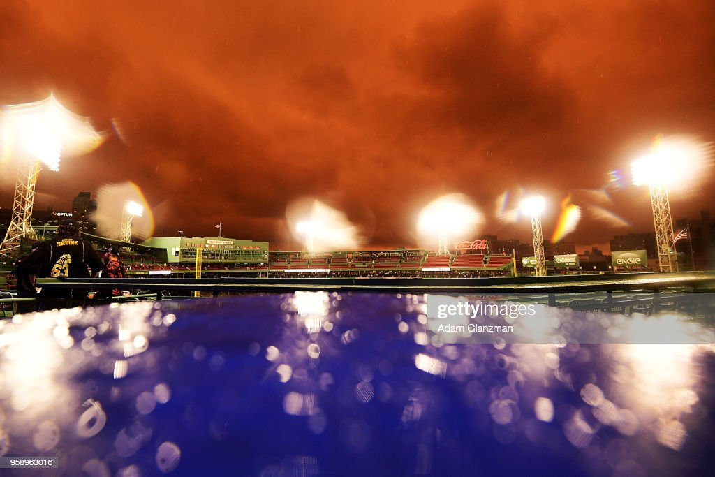 The sun sets over Fenway Park during a rain delay before a game between the Boston Red Sox and the Oakland Athletics on May 15, 2018 in Boston, Massachusetts.
