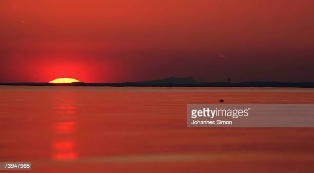 The sun sets over Lake Constance on April 22 in Langenargen Germany According to weather forcasts the unusual warm April weather continues with...