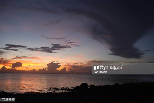 The sun sets over lake Okeechobee July 9 2007 in Pahokee Florida The lake has seen record low levels this year with elevated levels of arsenic and...