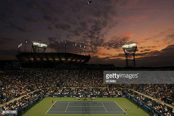 The sun sets over Louis Armstrong Stadium as Kim Clijster of Belgium plays against Kirsten Flipkens of Belgium during day five of the 2009 US Open at...