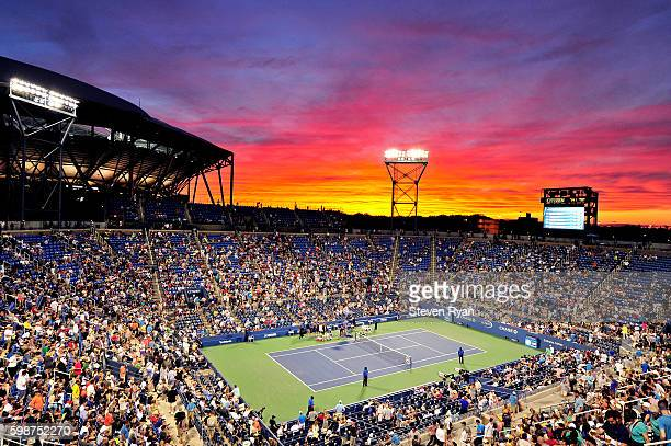 The sun sets over Louis Armstrong Stadium during the third round Men's Singles match between John Isner of the United States and Kyle Edmund of Great...