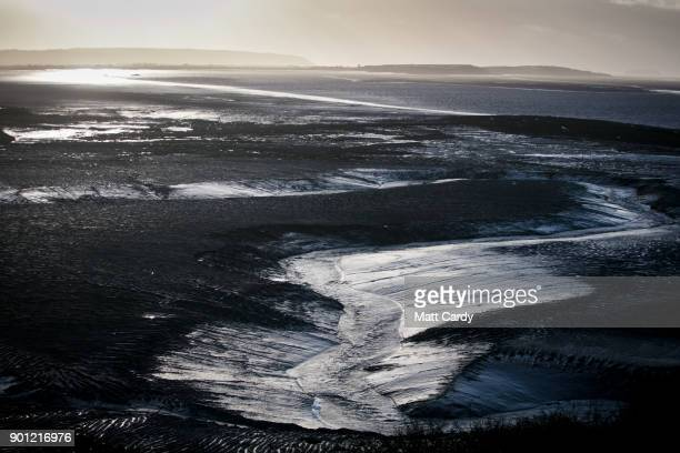 The sun sets over mud flats in Clevedon on January 4 2018 in North Somerset England According to the property website Zoopla house prices in the...