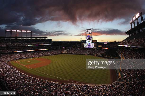 The sun sets over right field as the Oakland Athletics face the Colorado Rockies during Interleague Play at Coors Field on June 13, 2012 in Denver,...