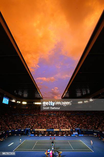 The sun sets over Rod Laver Arena in the men's final match between Andy Murray of Great Britain and Roger Federer of Switzerland during day fourteen...