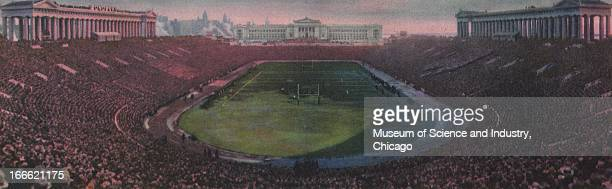 The sun sets over Soldier Field in Grant Park bathing the crowds in a red glow in a painting of the Century of Progress International Exposition in...