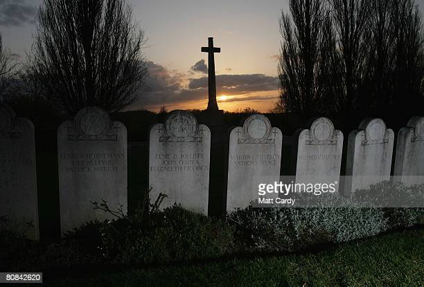 The sun sets over some of the graves of victims of the 1942 Bath Blitz in Haycombe Cemetery on April 23 2008 in Bath England 87yearold Luftwaffe...
