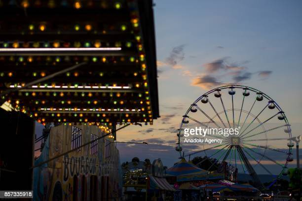 The sun sets over the amusement rides at The Great Frederick Fair in Frederick Md United States on September 15 2017