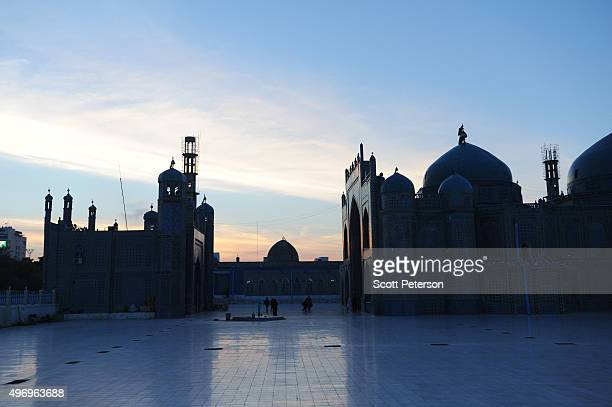 The sun sets over the ancient Blue Mosque as Afghans go about daily life despite security fears of a resurgent Taliban on November 10 2015 in the...