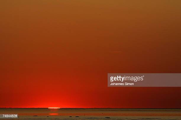 The sun sets over the Baltic Sea on June 11 at the island of Poel near Wismar Germany Meteorologists predict hot and sunny weather with temperatures...