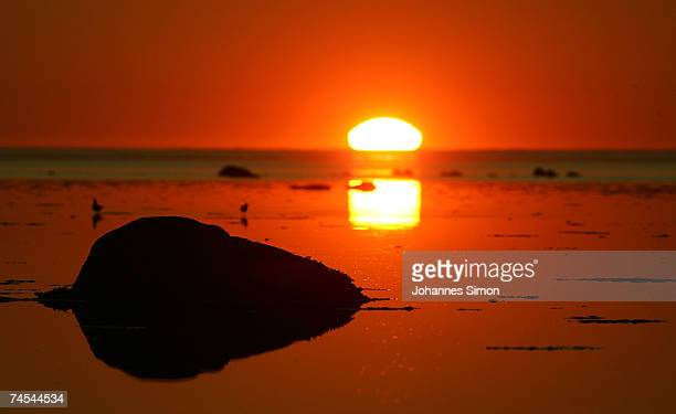 The sun sets over the Baltic Sea on Junel 11 at the island of Poel near Wismar Germany Meteorologists predict hot and sunny weather with temperatures...