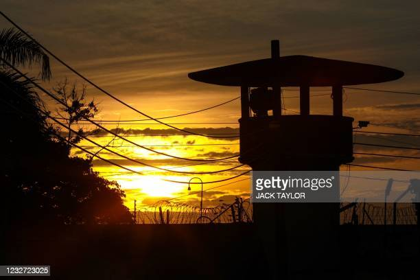 The sun sets over the Bangkok Remand Prison in Bangkok on May 6 as a Thai court on Thursday granted bail to prominent pro-democracy protest leader...