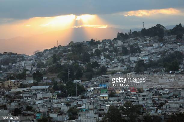 The sun sets over the capital city's Zone 18 infamous in Guatemala for gangrelated crime on February 10 2017 in Guatemala City Guatemala The...