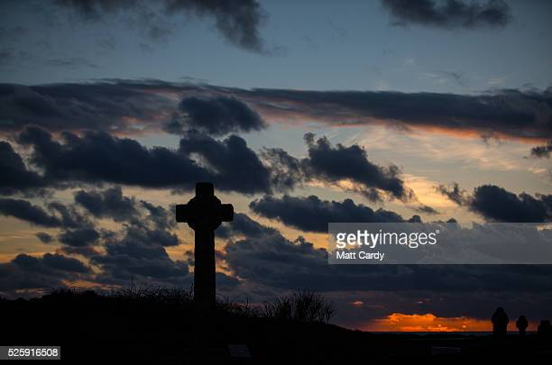 The sun sets over the church yard in Tintagel on April 27 2016 in Cornwall England The English Heritage managed site and the nearby town have long...