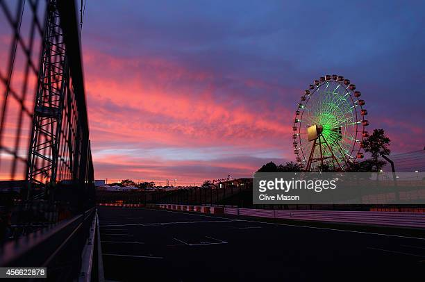 The sun sets over the circuit following Qualifying for the Japanese Formula One Grand Prix at Suzuka Circuit on October 4, 2014 in Suzuka, Japan.