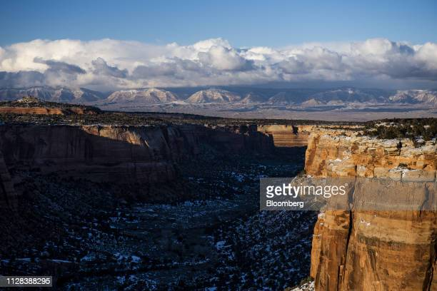 The sun sets over the Colorado National Monument in Grand Junction Colorado US on Tuesday Feb 19 2019 Colorado's Grand Valley whose economy has...