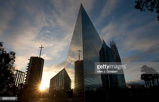 The sun sets over the Crystal Cathedral campus including theTower of Hope, left, and the Crystal Cathedral as a judge is expected to award a bid of...