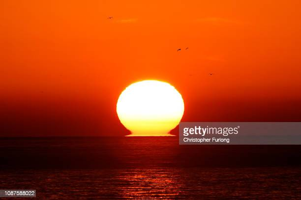 The sun sets over the English Channel as calm sea waters continue on December 28 2018 in Dover England The growing number of migrants attempting to...