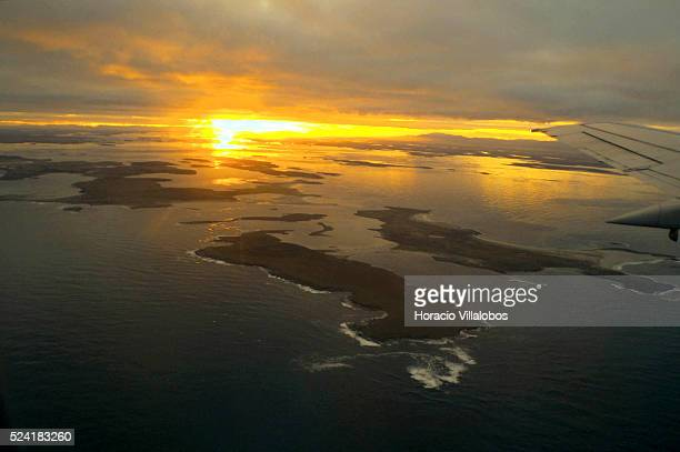 The sun sets over the Falkland Islands minutes before the LAN Chile plane lands at Mount Pleasant military airport LAN Chile is the only comercial...