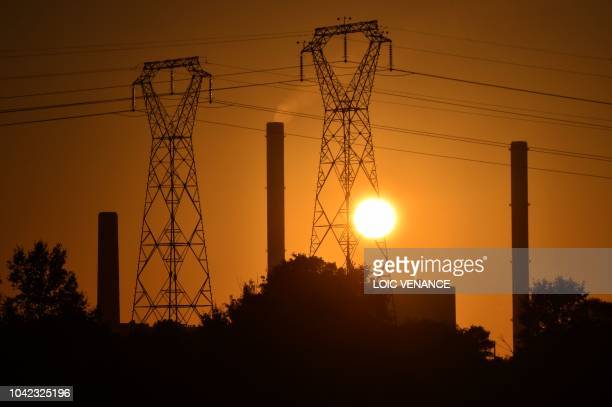 The sun sets over the French energy giant EDF powerplant of Cordemais one of the five last coal powerplant in France on September 28 2018 in...