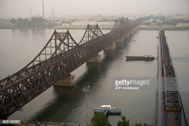 The sun sets over the Friendship bridge on the Yalu River connecting the North Korean town of Sinuiju and Dandong in the Chinese border city of...