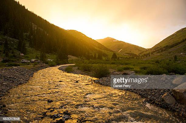 The sun sets over the Grouse Gulch aid station at mile 584 of the Hardrock 100 Endurance Run on July 11 in the San Juan Mountains Colorado The...