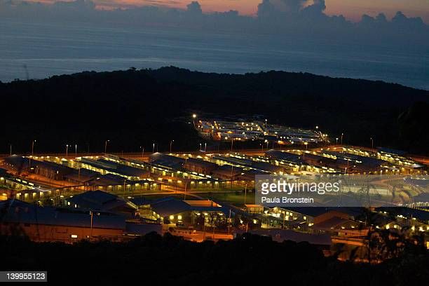 The sun sets over the Immigration Detention Center February 25 2012 on Christmas Island Australia So far in 2012 the total number of asylumseekers to...