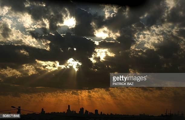 The sun sets over the Lebanese capital Beirut on February 5 2016 / AFP / Patrick BAZ
