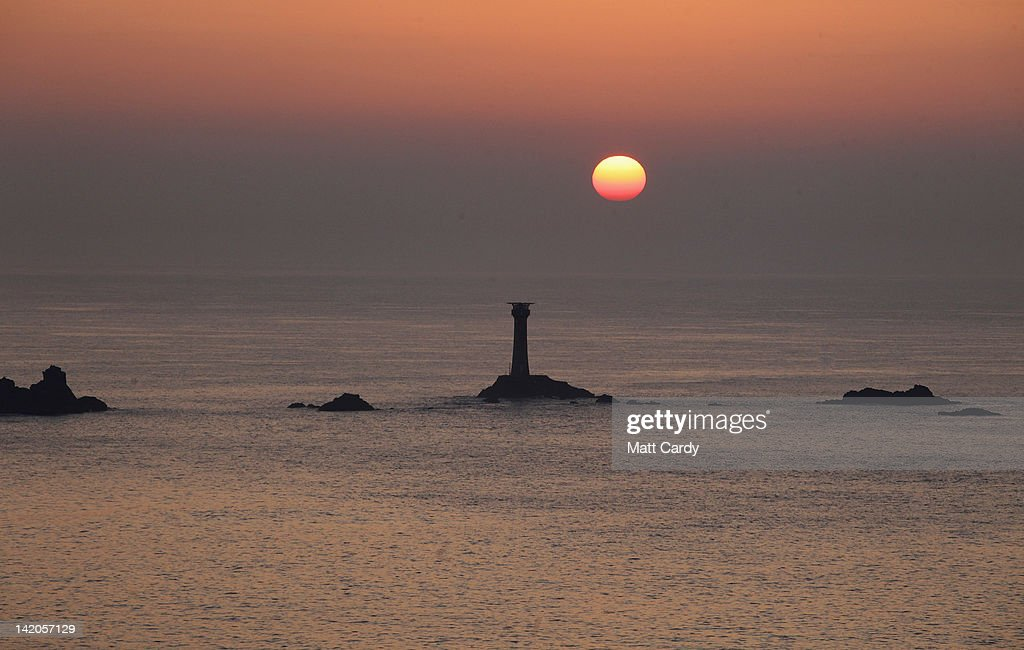 The sun sets over the Longships Lighthouse off Lands End on March 28, 2012 in Cornwall, England. With only a few months to go until the opening ceremony of the London 2012 Olympic games, Britain's tourist industry is hoping to benefit from the influx of athletes, officials and visitors.