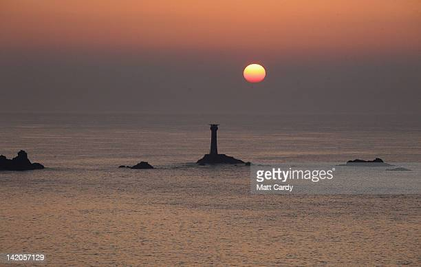 The sun sets over the Longships Lighthouse off Lands End on March 28 2012 in Cornwall England With only a few months to go until the opening ceremony...
