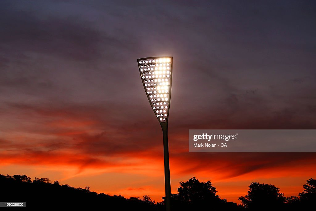 The sun sets over the Manuka Oval light towers during game three of the One Day International Series between Australia and South Africa at Manuka Oval on November 19, 2014 in Canberra, Australia.
