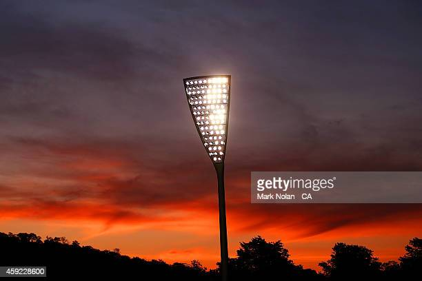 The sun sets over the Manuka Oval light towers during game three of the One Day International Series between Australia and South Africa at Manuka...